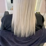 woman with long straight platinum hair