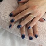 dark blue nails with silver glitter