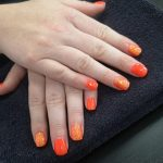 orange glittery gel nails