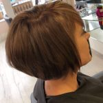 woman with short pixie crop haircut